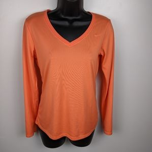 The Nike Tee Women's Orange V Neck Long Sleeve Top